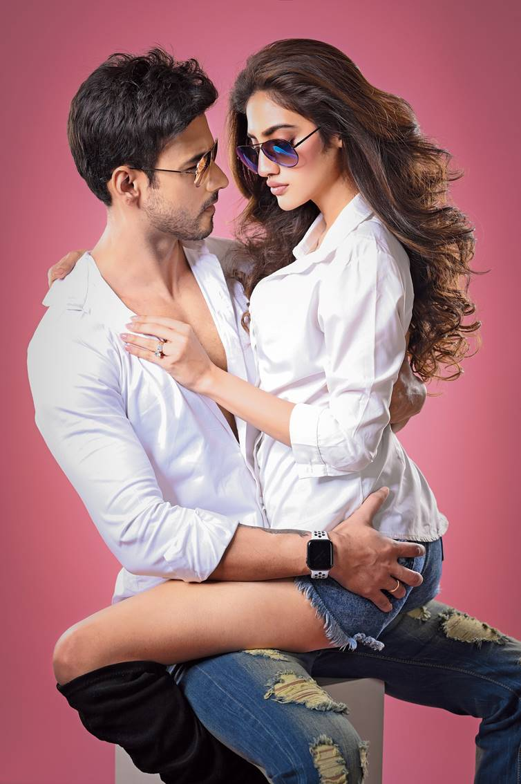 """1. Nusrat and Yash channelled cool and casual oomph in the classic combination of white and blue. """"I would love to wear denims and a white shirt for the Saptami morning,"""" said Nusrat. Yash feels it """"always works wonders with the girls"""". """"This works all the time and it can never go wrong. Even a black shirt works well. I have a lot of them and when I am confused that's what I wear,"""" said Yash. (Shirt and jeans: Zara; eyewear: Idee)"""