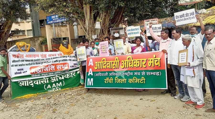 Members of the Adivasi Adhikar Manch at a protest  at Saiko in Khunti on Thursday demanding the release  of Stan Swamy