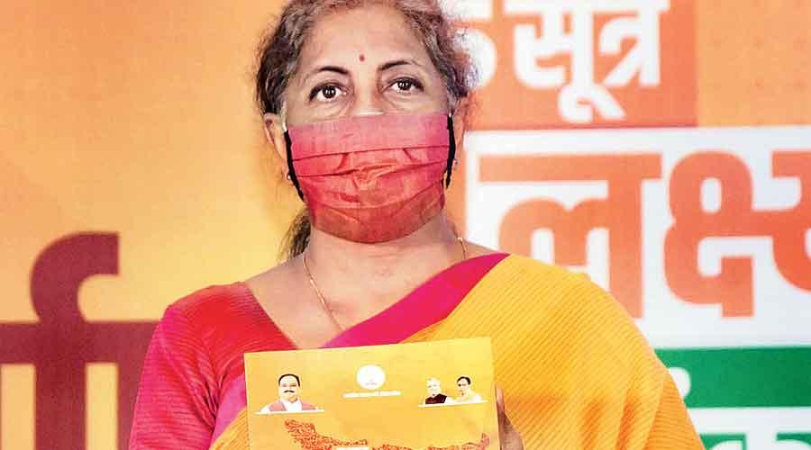 Nirmala Sitharaman with the manifesto in Patna
