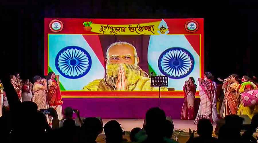 Prime Minister Narendra Modi gestures as he inaugurates a Durga Puja pandal via videoconferencing in New Delhi on Thursday.