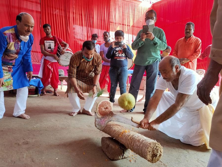 The priest performs the ritual of sacrificing vegetables after the Kumari Puja at Deshpriya Club.
