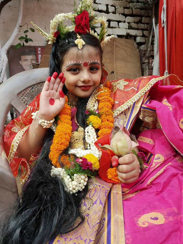 The Holy Child after the Kumari Puja at Deshpriya Club.