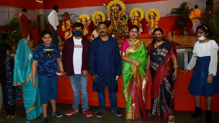 Amit Ghosh, a Bangalore-based IT professional, at a pandal with his family in Bistupur on Saturday.