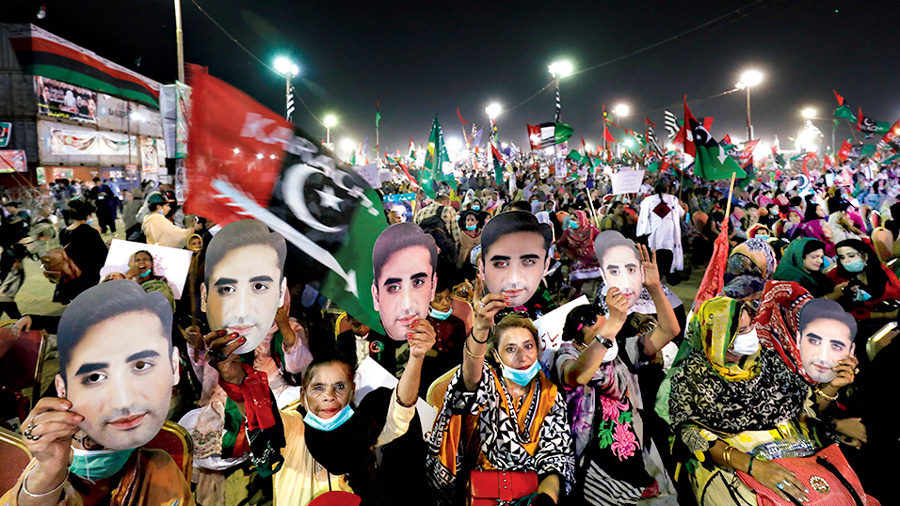 Supporters of the Pakistan Peoples Party (PPP) hold up masks depicting their leader Bilawal Bhutto Zardari, chairman of the PPP, during an anti-government protest rally organized by the Pakistan Democratic Movement (PDM), an alliance of political opposition parties, in Karachi, Pakistan October 18, 2020.
