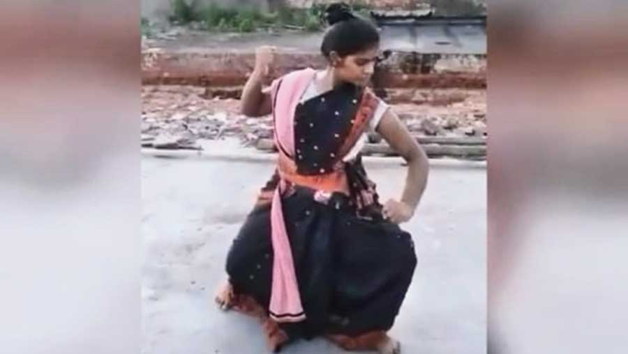 A scene from the video: a girl presents a dance performance