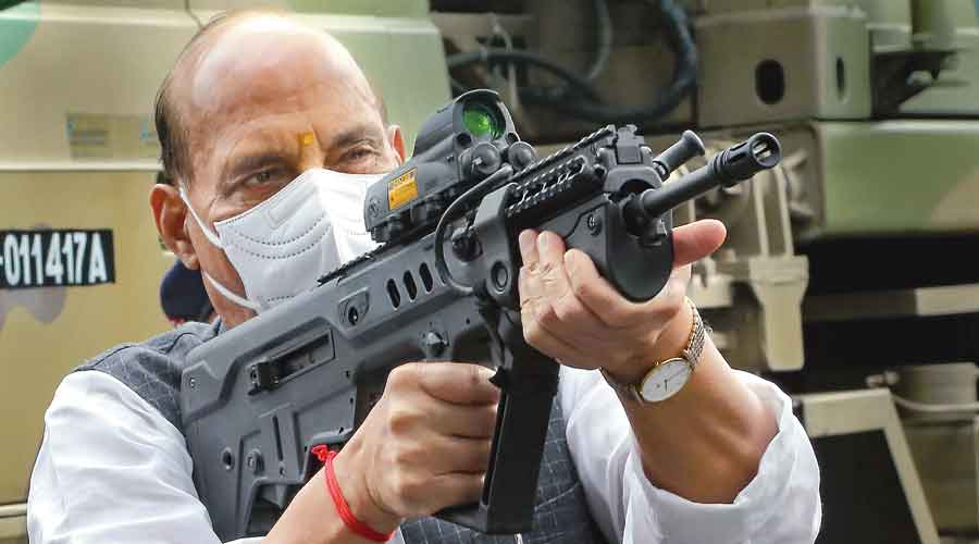 Defence minister Rajnath Singh inspects a weapon at the Sukna army camp  in Darjeeling on Sunday