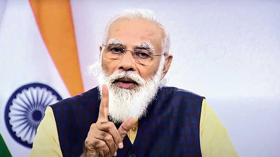 Narendra Modi addresses the energy forum in New Delhi on Monday.