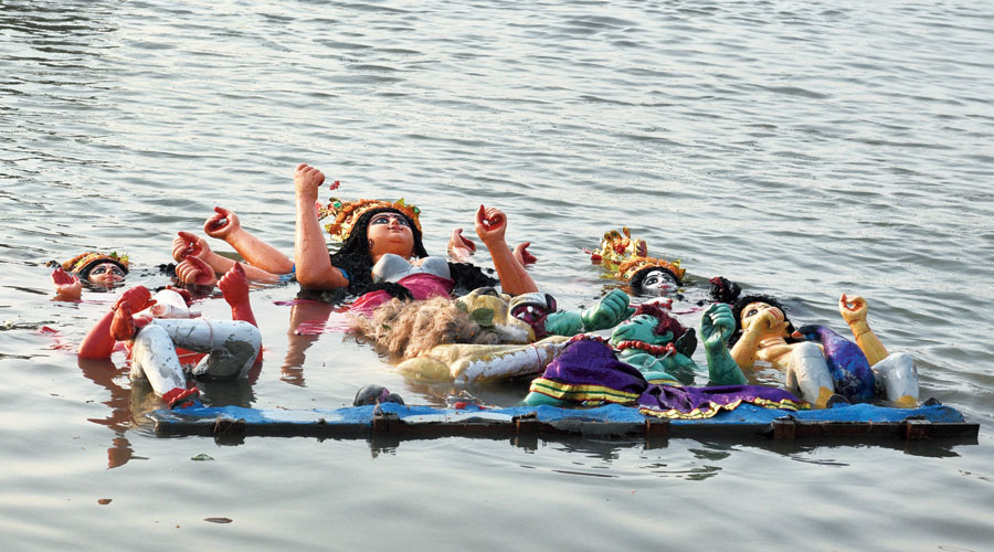 A Durga idol after immersion at Babughat on Monday.