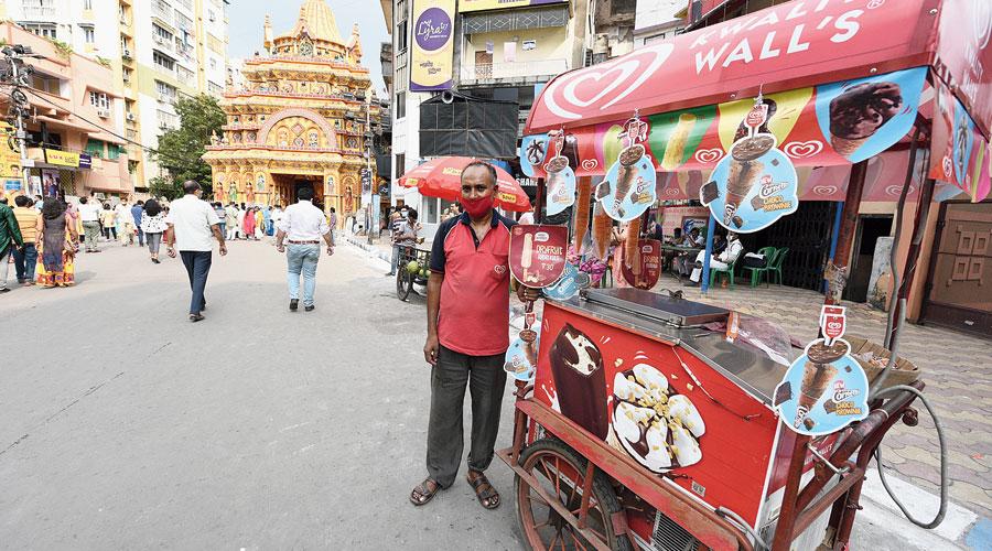 Gulam Mustafa with his ice cream cart outside Ekdalia Evergreen puja pandal on Sunday.