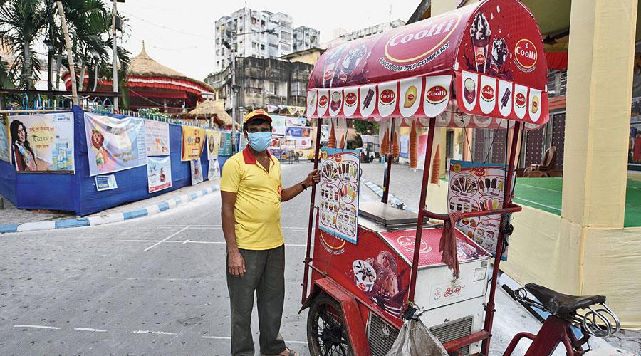 Dilip Sardar with his cart at the crossing of Pratapaditya Road and Rashbehari Avenue on Sunday.