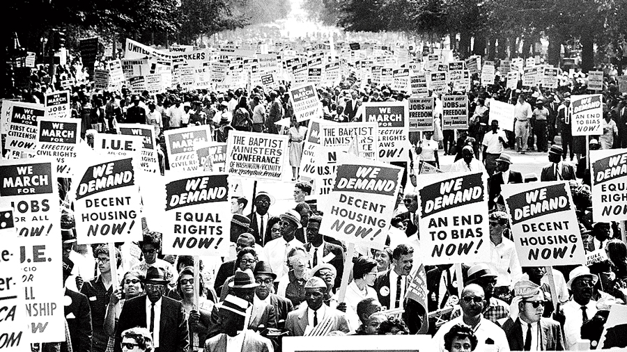 Civil rights Leaders hold hands as they lead a crowd of hundreds of thousands at the March on Washington for Jobs and Freedom, Washington DC, August 28, 1963. Those in attendance include (front row): James Meredith and Martin Luther King, Jr. (1929 - 1968), left; (L-R) Roy Wilkins (1901 - 1981), light-colored suit, A. Phillip Randolph (1889 - 1979) and Walther Reuther (1907 - 1970).