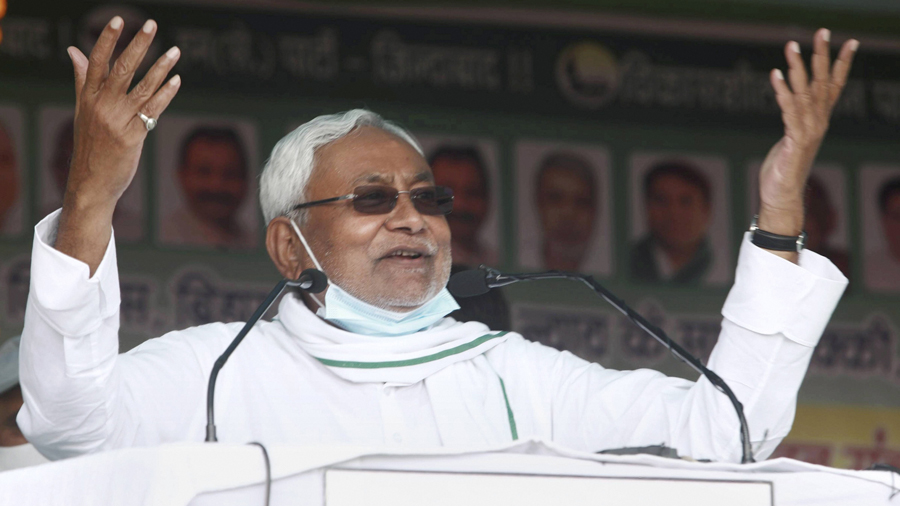 Bihar Chief Minister Nitish Kumar addresses a gathering during an election rally ahead of Bihar assembly polls, in Khagaria district, Saturday, Oct. 24, 2020.