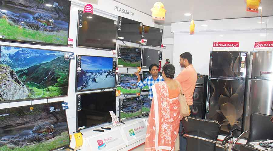 Customers at an electronic shop in Dhanbad on Wednesday.