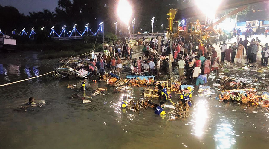 Idol immersion in the Hoogly during low tide on Monday.