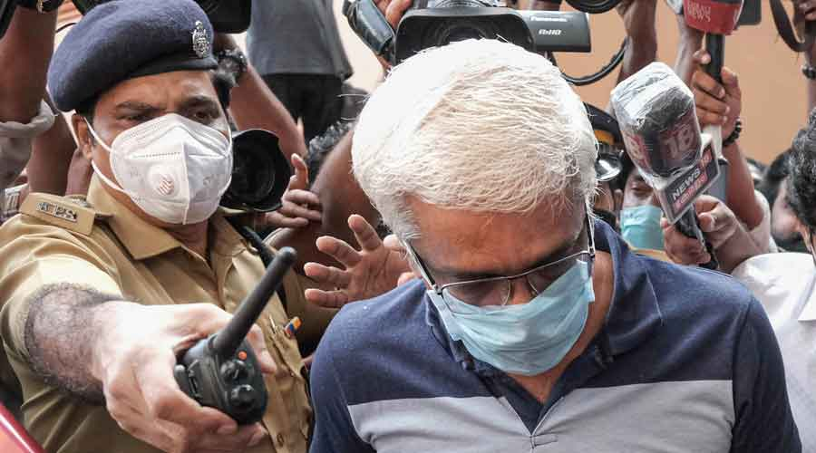 Suspended IAS officer M. Sivasankar being taken into custody by Enforcement Directorate (ED) for questioning in connection to the Kerala gold smuggling case