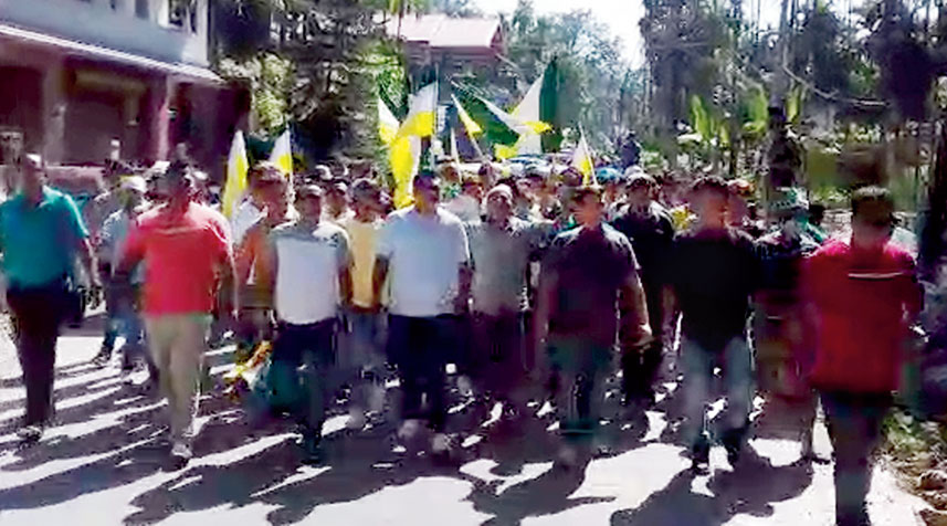 Supporters of the Morcha's Tamang faction take out a procession against Bimal Gurung in Kalimpong on Wednesday