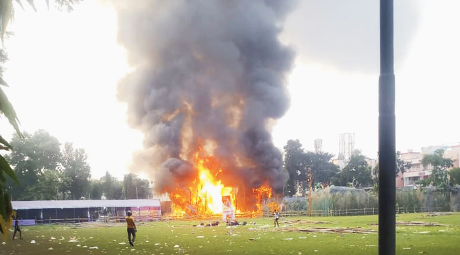 Flames leap out of the FD Block puja pandal on Wednesday