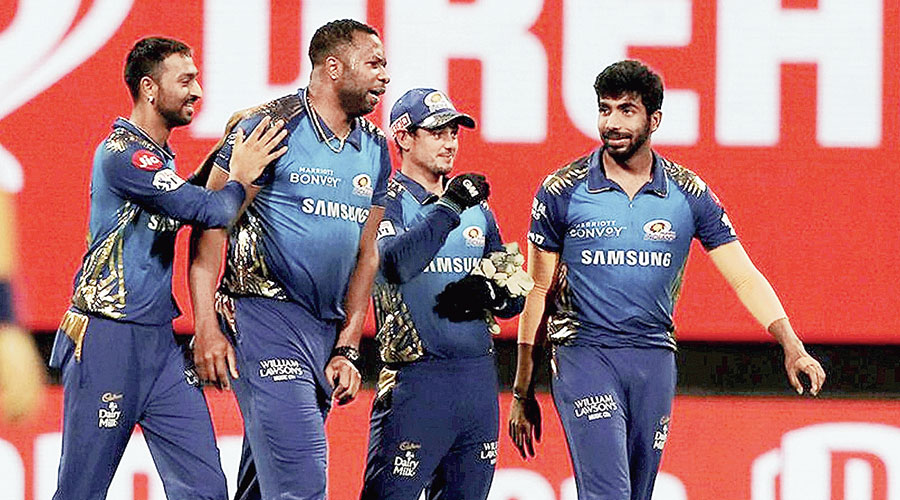 Mumbai Indians players celebrate the prized  wicket of AB de Villiers on Wednesday.