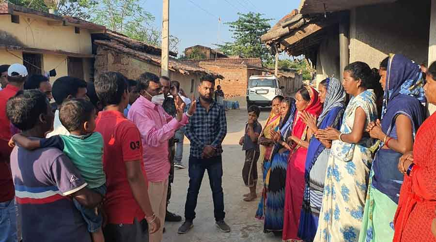 Gomia MLA Lambodar Mahto talks to family members of youths who have been allegedly held hostage by a Chennai company on Wednesday in Bokaro.