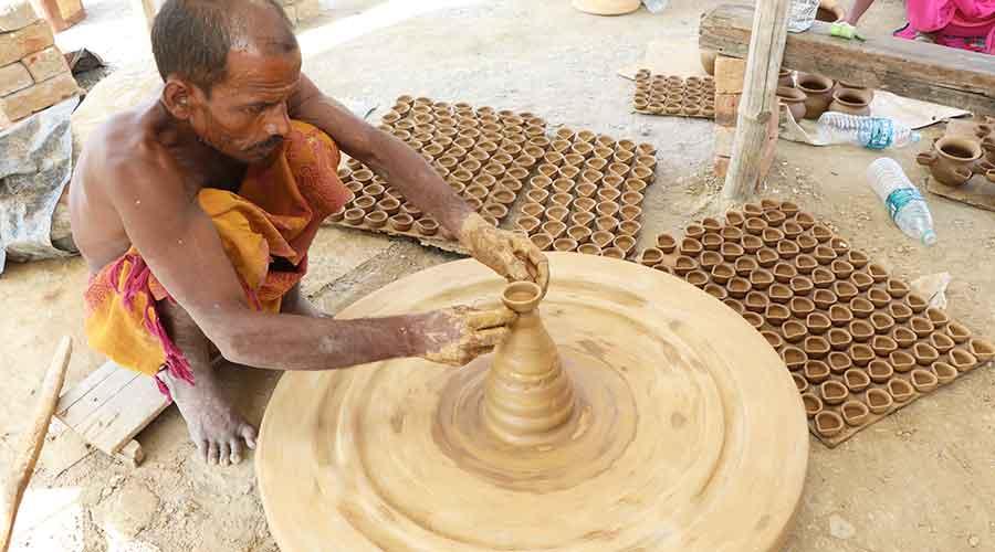 Potters make diyas for Diwali at Mango on Wednesday.