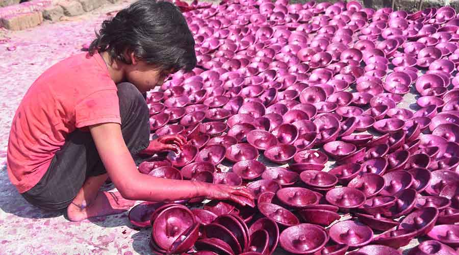 A potter's family busy colouring and drying earthen toys and utensils for Diwali at their residential workshop in Duhatand, Kumhartola in Barmasia,Dhanbad on October 29, 2020..