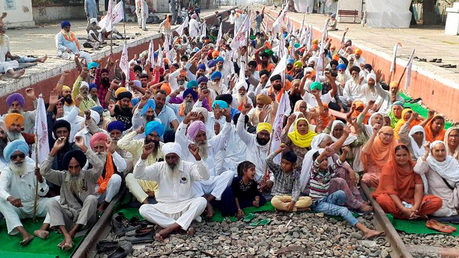 Farmers block railway tracks during a protest against the new farm bills, at Jandiala Guru in Amritsar, Thursday, Oct. 29, 2020.