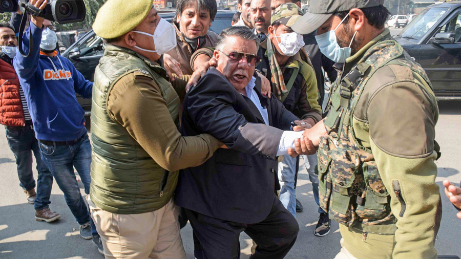 Peoples Democratic Party (PDP) members detained by police during their protest against the new land law, in Srinagar, Thursday, Oct. 29, 2020.