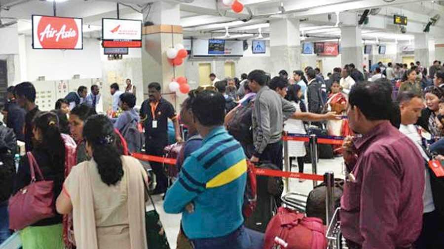 Passengers at the Bagdogra airport terminal.