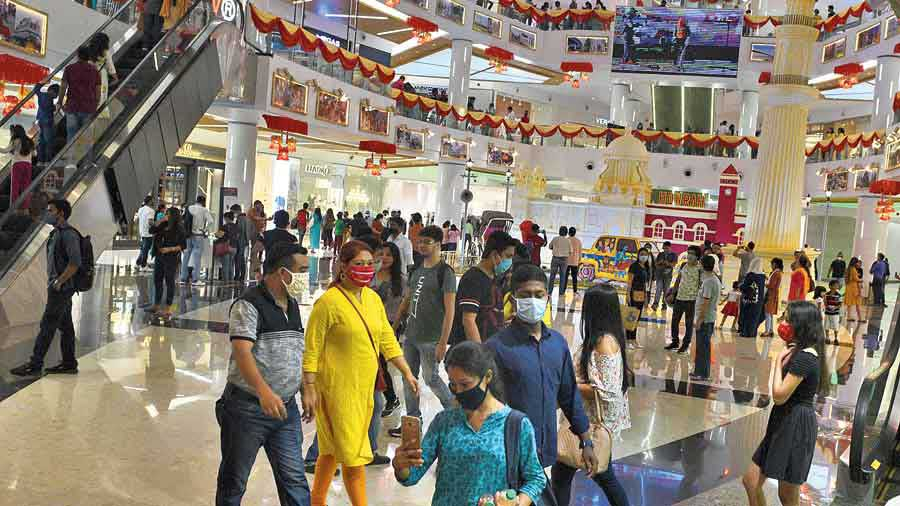 Puja shoppers at South City Mall on Sunday evening.