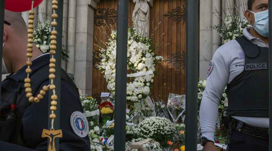 Gendarmes secure gates outside the Notre-Dame basilica in Nice, France on Friday