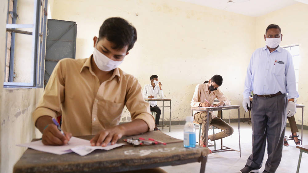 Students appear in the 12th standard board exam at Government Patel School, during fifth phase of nationwide Covid-19 lockdown, in Beawar.
