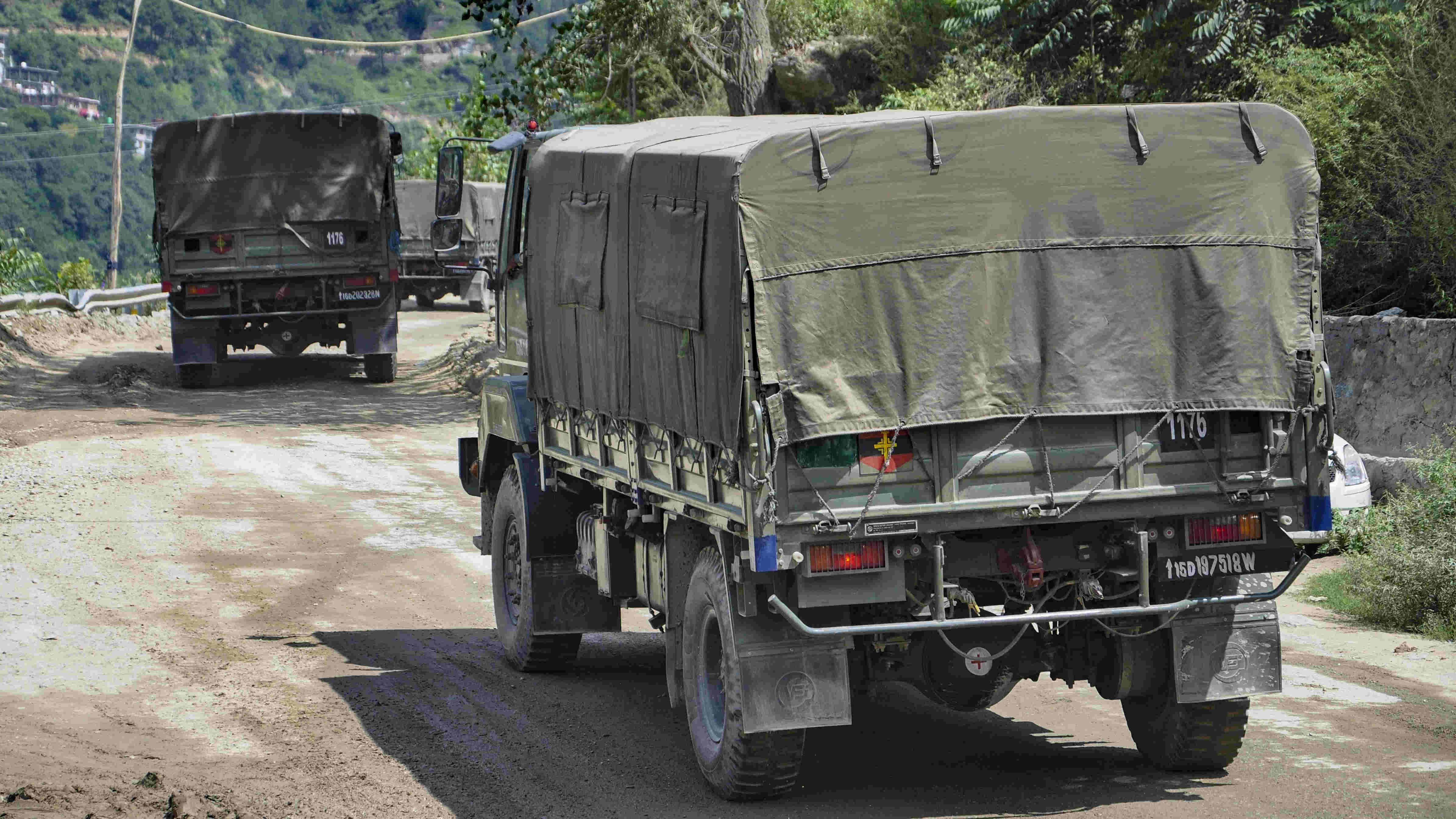 Army trucks move towards Ladakh via Leh–Manali Highway in Manali on Sunday.