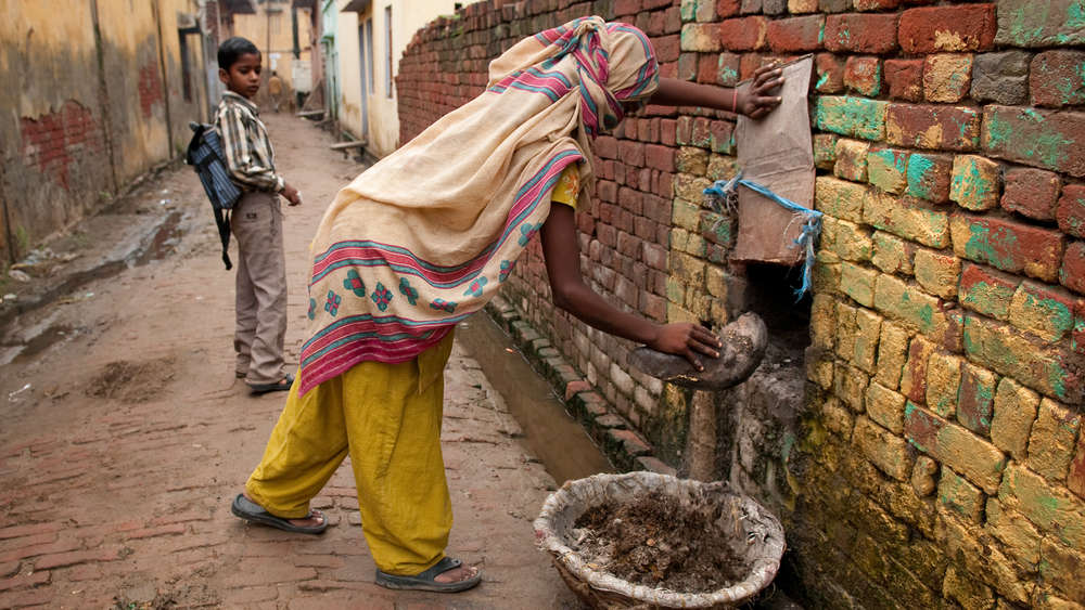 A dalit woman does manual-scavenging from a home in Haryana.