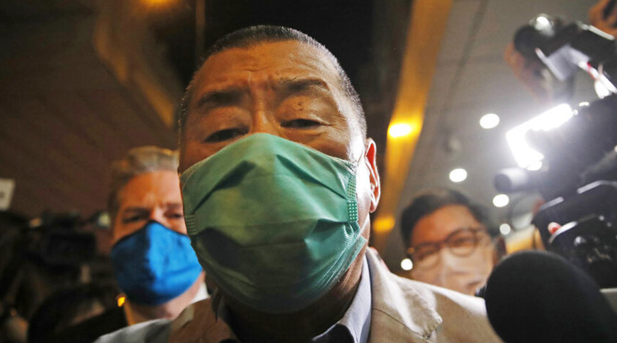 Media tycoon leaves a  court in Hong Kong on Thursday. (AP)