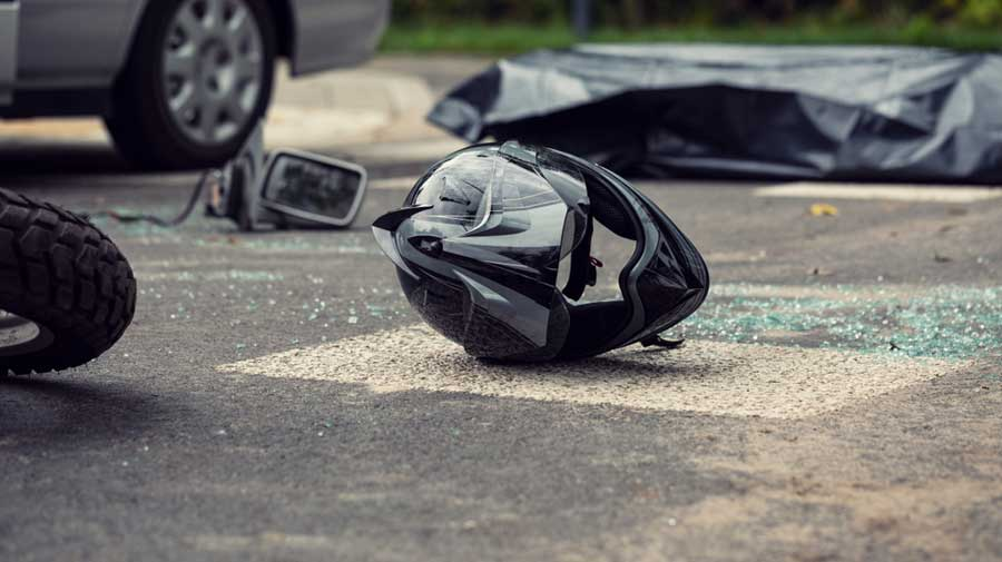 The person on the pillion escaped from being crushed under the lorry's wheels as he was flung off the two-wheeler on impact and he landed a few metres from Lenin Sarani.