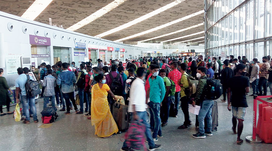 A crowd in front of airlines' ticket counters inside gate 3C of the airport on Thursday