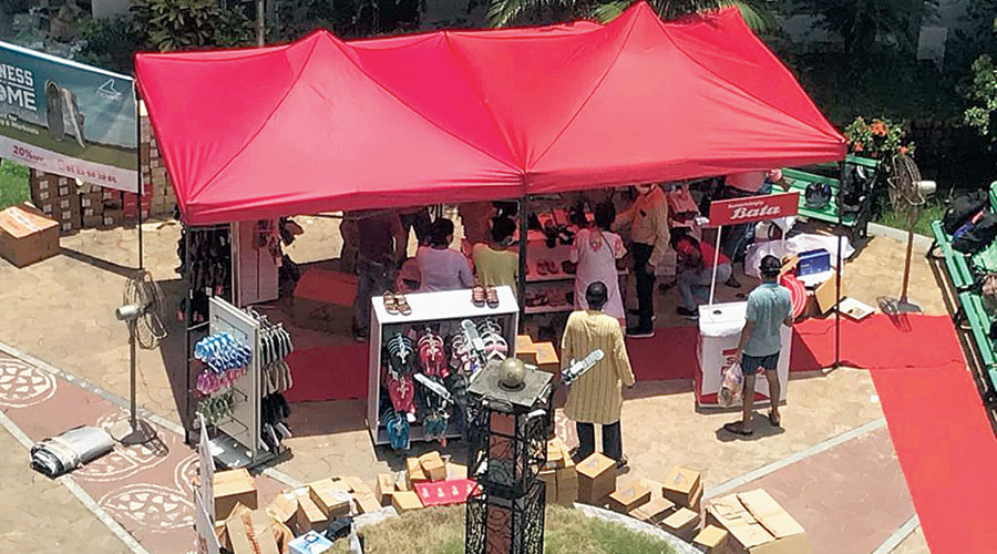 Residents of Sugam Park, a housing complex in Narendrapur, check out items at Bata