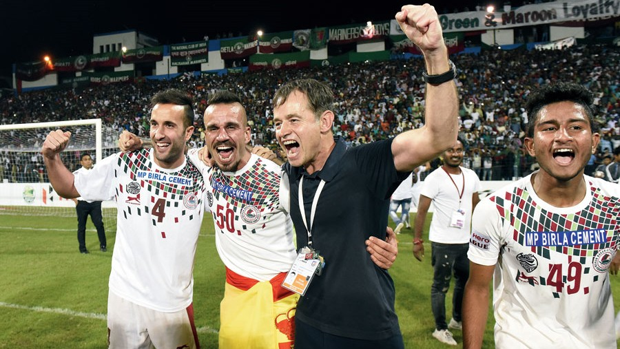 Mohun Bagan's Fran Morante, Fran Gonzalez, coach Kibu Vicuna and Subha Ghosh celebrate after securing the I-League title with a 1-0 win over Aizwal FC earlier this year.