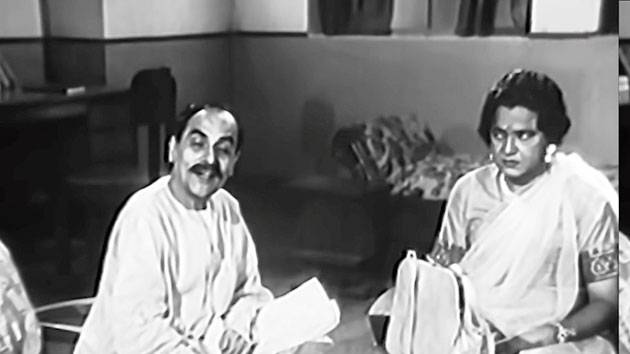 4. This is another hallmark in the illustrious career of Bhanu Bandyopadhyay. Needless to say, he is playing a woman in this scene. Name the movie and the co-actor, who himself was a tremendous talent and impressed Rabindranath Tagore and Mahatma Gandhi through his songs. He was also a favourite of Satyajit Ray.