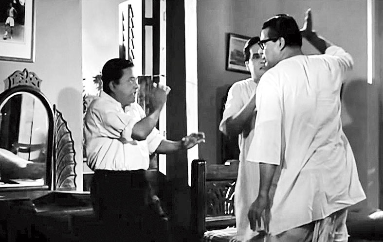 6. This is a hilarious scene involving a father-son duel. The father is of course very angry in this scene. Who is playing the father and who are playing the sons?