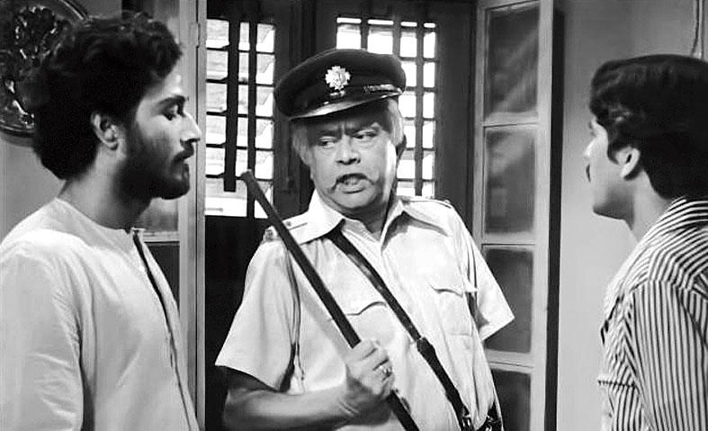 8. In this movie, Bhanu Bandyopadhyay represented the system and all that is wrong with the system. Cine lovers still remember him saying in his caustic tone – 'In the Indian penal code, the father is not hanged for a murder committed by the son!' This movie launched another very talented actor who is present in this scene. Who was this actor?