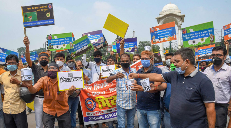Coaching teachers and owners during a protest, demanding to reopen the educational institutes on Teachers day in Patna on Saturday.