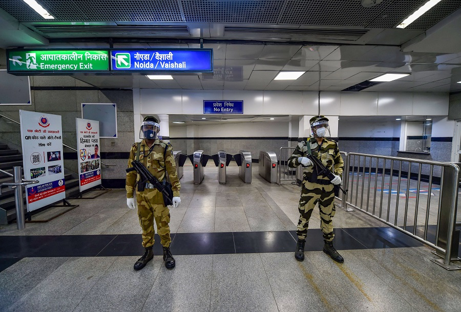 Security personnel stand guard at Rajiv Chowk station in New Delhi on Monday.