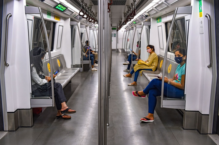 Commuters travel in a metro train in New Delhi on Monday.