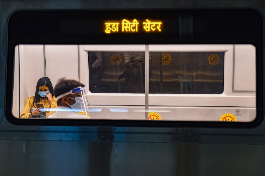 Commuters maintain social distancing in a metro in New Delhi on Monday.