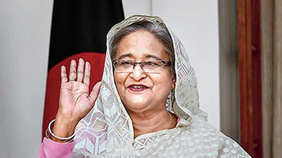 Hasina goes global, Modi local