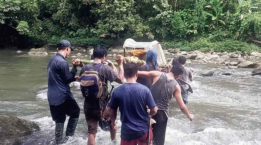 Villagers from Gandhigram under Vijoynagar circle in Arunachal Pradesh's Changlang district, which borders Myanmar, carry a patient on a bamboo stretcher to a hospital in Miao, 157km away.