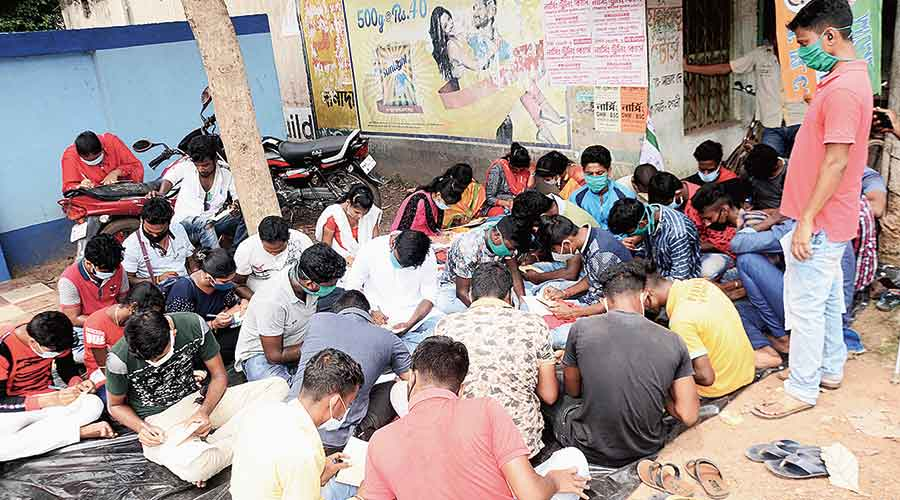 Students write the letters in Hooghly's Goghat  on Wednesday.