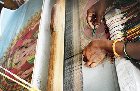 Khadi sari pallus being woven with images from paintings of Raja Ravi Varma