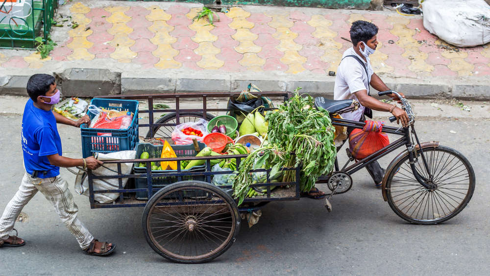 Calcutta, May 23, 2020: People who have lost their jobs during lockdown are now vending vegetables on roads to make their living.